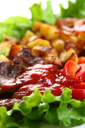 Meat plate with potatoe and souce Stock Photo - 8320012
