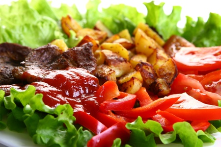 Meat plate with potatoe and souce Stock Photo - 8319895