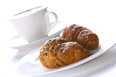 Fresh croissant with black coffee  photo