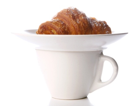 a fresh croissant with black coffee photo