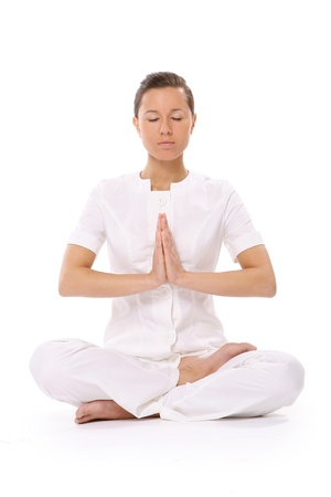 meditation isolated white: beautiful young woman in yoga pose Stock Photo