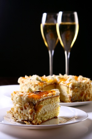 two glasses of champagne with cakes photo