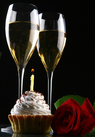 two glasses of champagne with rose photo