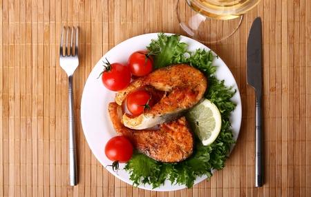 a fresh salmon garnish with salad photo