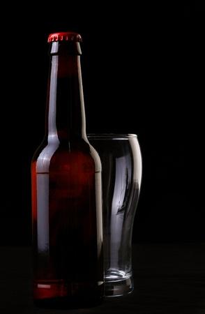 two wine glasses on black photo