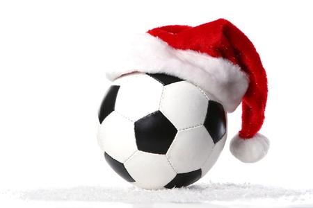 jugadores de futbol: una pelota de f�tbol con tapa de Navidad Foto de archivo