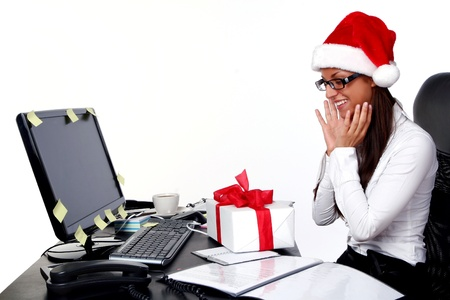 female christmas: a business young and beautiful woman in office
