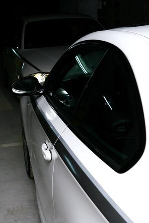 white car on black background Stock Photo - 8321292