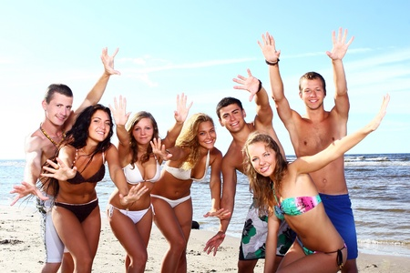 happy teenagers playing in the sea photo