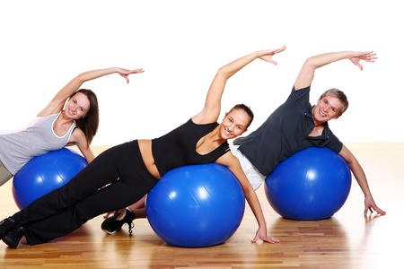 fitness ball: people group  doing fitness exercise