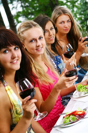 group of beautiful woman drinking wine photo