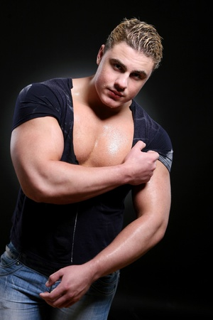young and beautiful muscles man photo