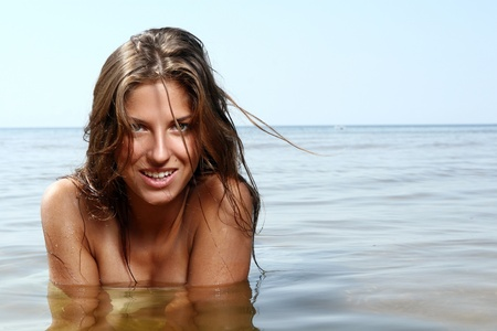 sexy and beautiful woman in the sea photo