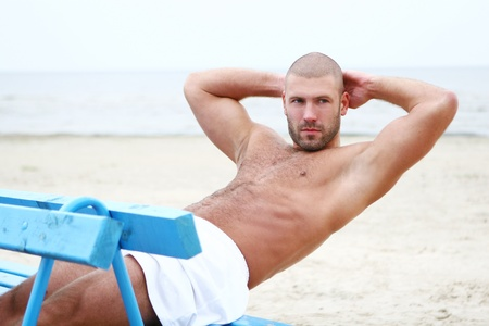 guy on beach: attractive and happy man on the beach Stock Photo