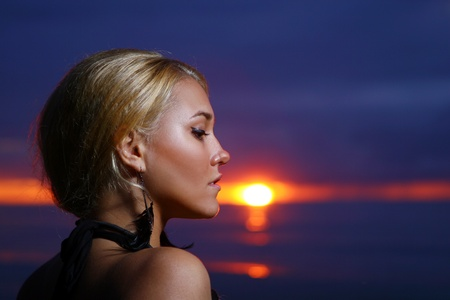 sexy and luxury woman on sunset backgroung photo