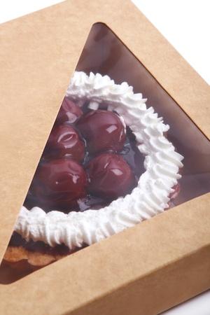 fresh and tasty sweet cherry cake in the box photo