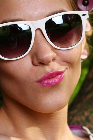 beautiful young woman with sun glasses photo