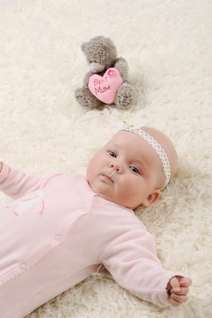 young and beautiful baby in pink Stock Photo - 8673810