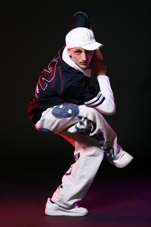hip hop dancer doing dance exercses photo