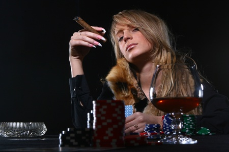 croupier: beautiful woman who smoke cigar