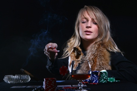 beautiful woman who smoke cigar Stock Photo - 8733848