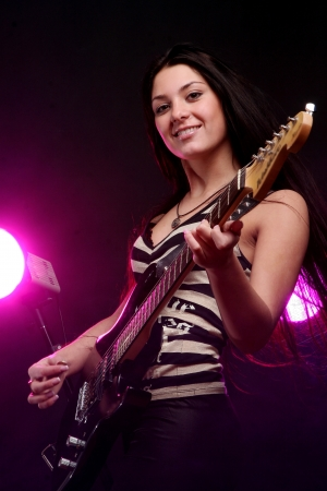 guitar player: happy smiling teen playing guitar Stock Photo