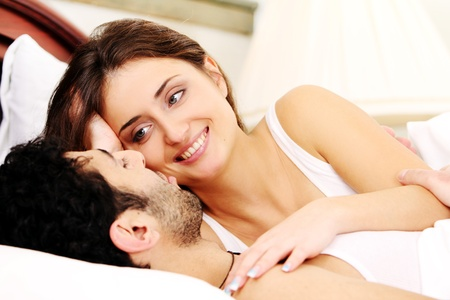 Young and beautiful couple in bed photo