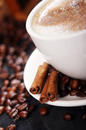 Coffee cup on the table with beans around photo