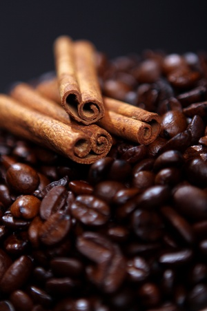 Coffee beans and canella sticks close up photo