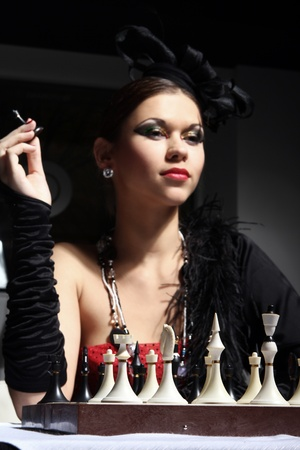 Young and sexy vintage woman posing beside chess table Stock Photo - 8673993