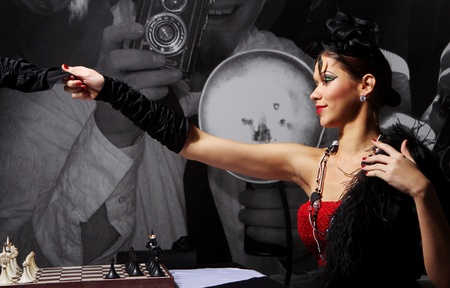 Young and sexy vintage woman posing beside chess table Stock Photo - 8673998