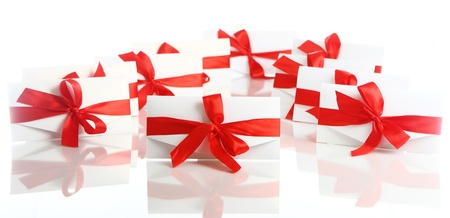 Gift envelopes with awesome red bows isolated on white  photo