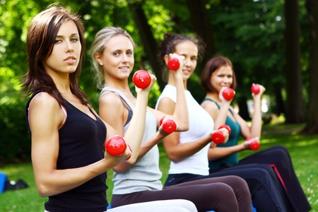 fitness ball: Young and attractive womans doing fitness exercises in park
