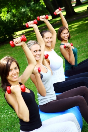 Young and attractive womans doing fitness exercises in park Stock Photo - 8673981