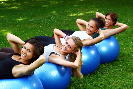 outdoor fitness: Young and attractive womans doing fitness exercises in park