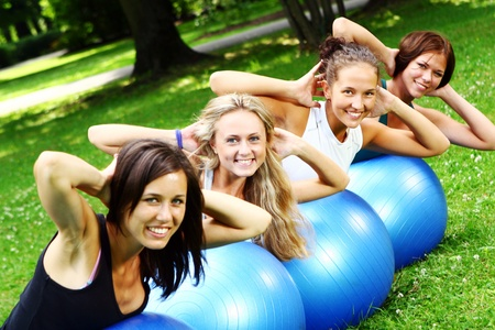 Young and attractive womans doing fitness exercises in park Stock Photo - 8673983