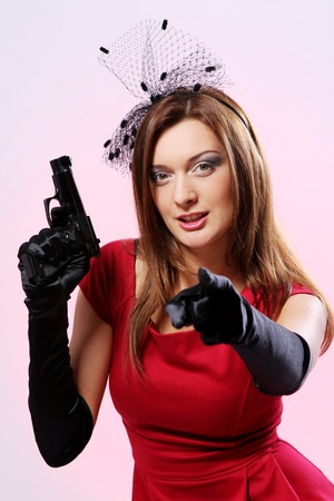 Attractive and sexy spy woman with pistol on white background Stock Photo - 8968065