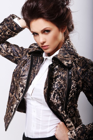 Attractive woman in leather jacket on white background photo