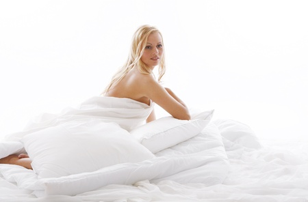 bed sheet: Beautiful woman relax in bed Stock Photo