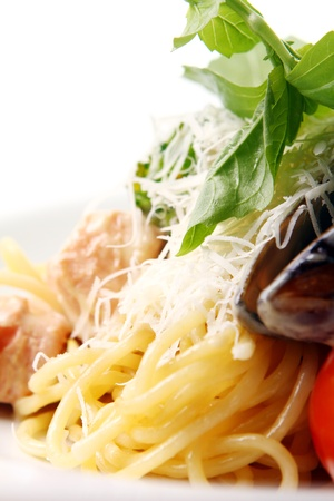 Delicious Spaghetti and meat with cheese basil and mussels photo