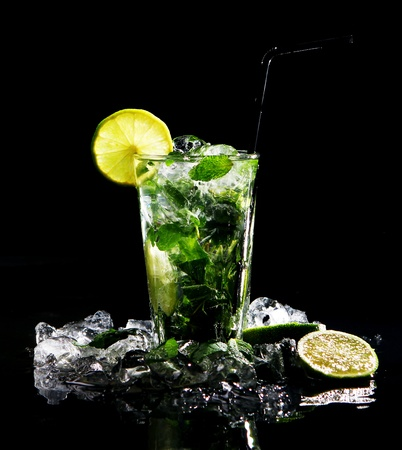 coctail: Fresh drink with ice, green mint and lime on black background Stock Photo