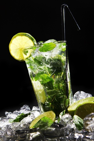 Fresh drink with splashesh of water, green mint and lime on black background Stock Photo - 8936859