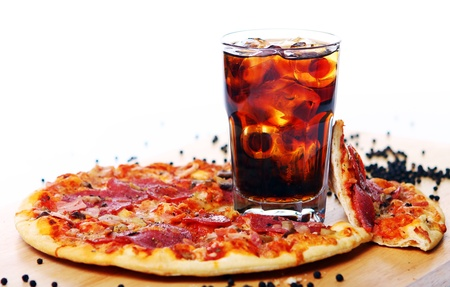 soda splash: Fresh pizza with salami and mushrooms and cold cola drink  Stock Photo