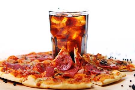 dough: Fresh pizza with salami and mushrooms and cold cola drink  Stock Photo