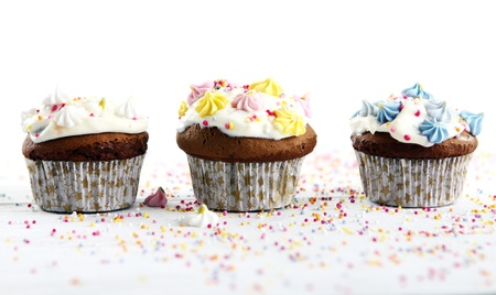 icing sugar: Holiday cupcakes decorated with colorful flowers