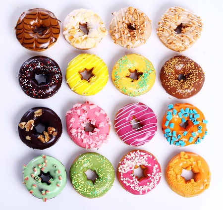 glaze: Colorful and tasty donuts on white background Stock Photo