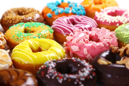 donuts: Colorful and tasty donuts on white background Stock Photo