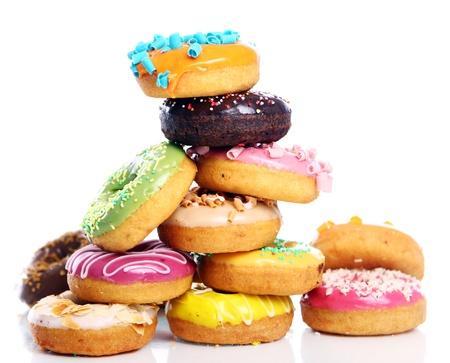 Kleurrijke en smakelijke donuts op witte achtergrond Stockfoto