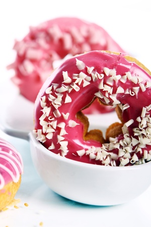 Colorful and tasty donuts on white background photo