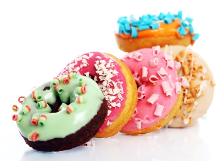 chocolate sprinkles: Colorful and tasty donuts on white background Stock Photo